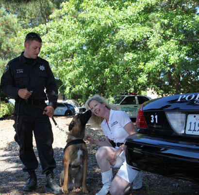 K-9 Armor is proud to protect Richmond PD K9 Ranger, pictured with his handler Officer Caine and Suzanne Saunders, K9 Armor CoFounder