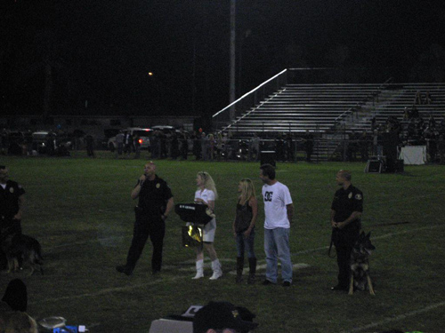 Anaheim PD Officer Boncawicz with K9 Cisko, OCPCA Pres and Irvine PD K9 Officer Bob Smith, K-9 Armor CoFounder Suzanne Saunders presenting a bulletproof K9 Armor vest thanks to sponsors Krista and Mike Pennington, followed by Huntington Beach PD Officer Ricci with K9 Xavi at the Orange County Police Canine Association K9 Benefit Show, October 15, 2011