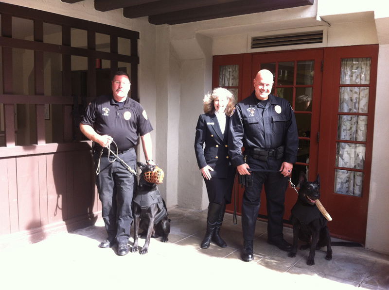 Riverside PD Officer Brad Smith with K9 Finn and Officer Darrel Hill with K9 Noran and K9 Armor cofounder Suzanne Saunders