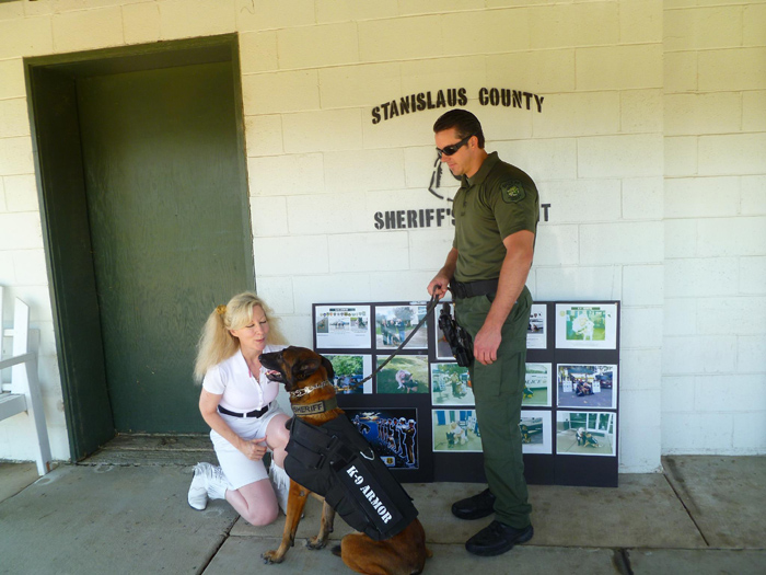 K9 Armor Cofounder Suzanne Saunders with Stanislaus County Sheriff K9 Smoke and Deputy Thompson