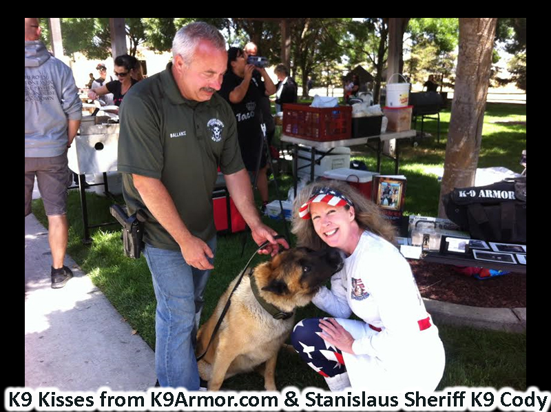 K9 Kisses from Stanislaus County Sheriff K9 Cody to K9 Armor cofounder Suzanne Saunders.