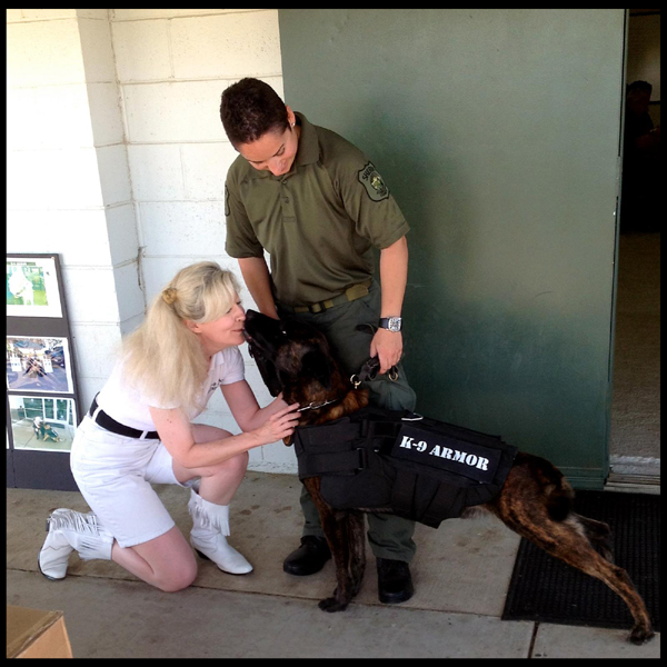 Stanislaus County Sheriff K-9 Sam gives kisses to Suzanne Saunders for his K9 Armor bulletproof vest. Photo by Karen Introcaso