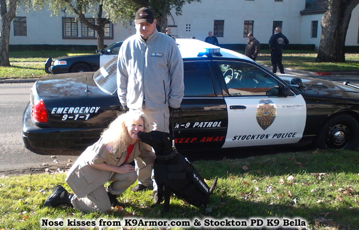 Stockton PD K9 Bella gives kisses to Suzanne Saunders, K-9 Armor Co-Founder